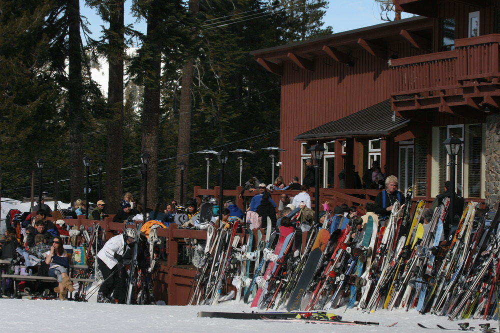 Skiers and snowboarders take a break to relax at a lodge at Sugar Bowl Ski Resort, California