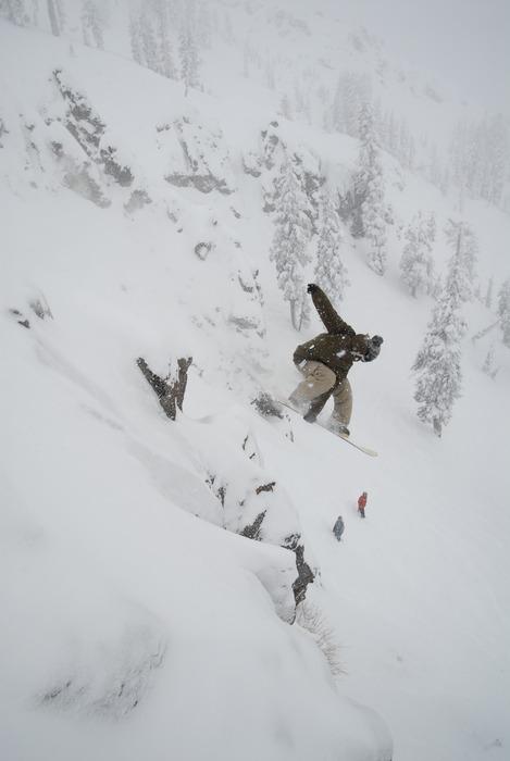 This snowboarder drops into some new powder at Sugar Bowl Ski Resort, California