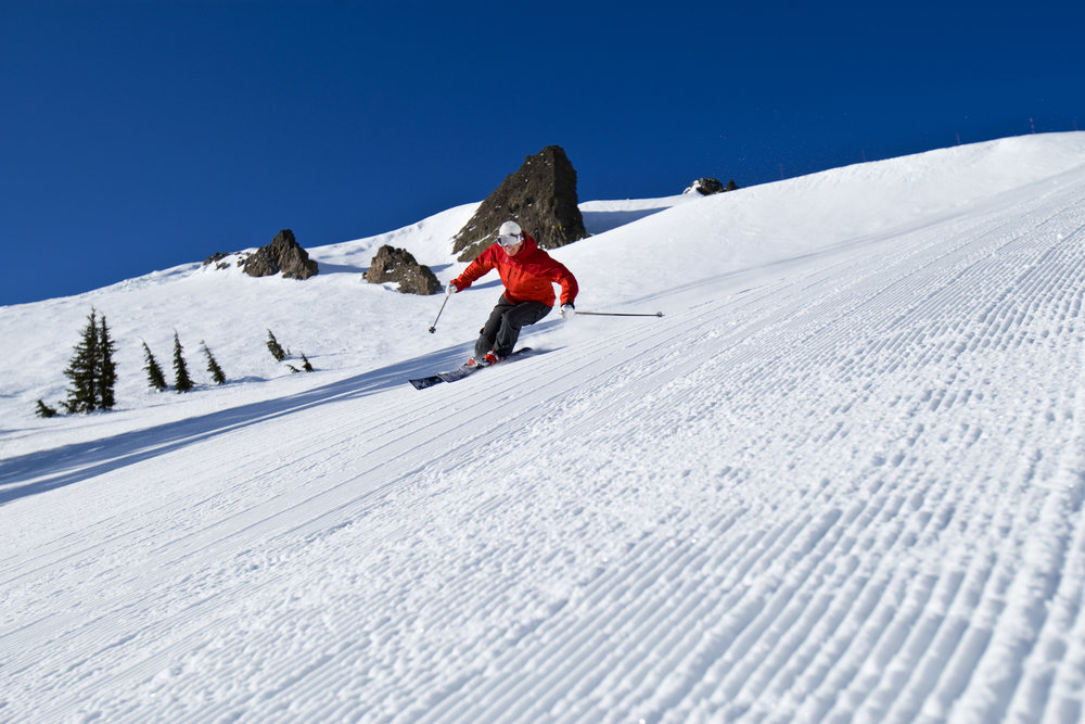 This skier finds a freshly groomed run to go down at Alpine Meadows, California