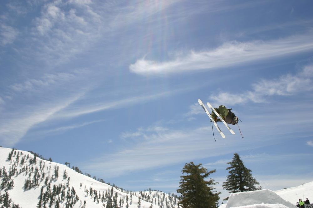 A skier gets major air off a jump in the terrain park at Mt. Baldy Ski Resort, California