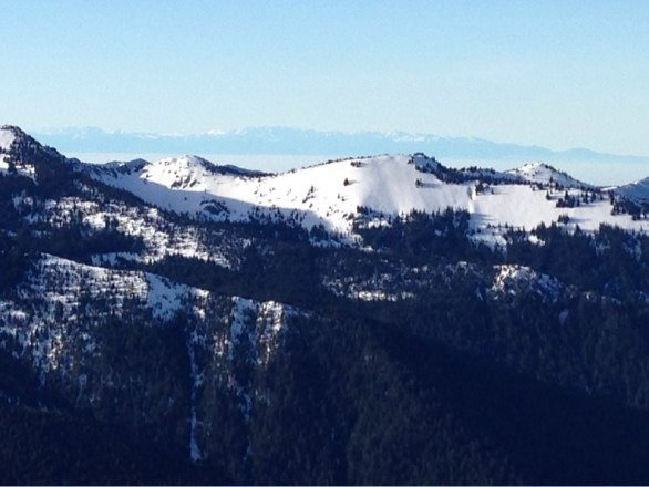 Great day. Sunny at the slopes. Notice the fog covering the low lands between the Olympics and cascades. Nice to see the blue sky's