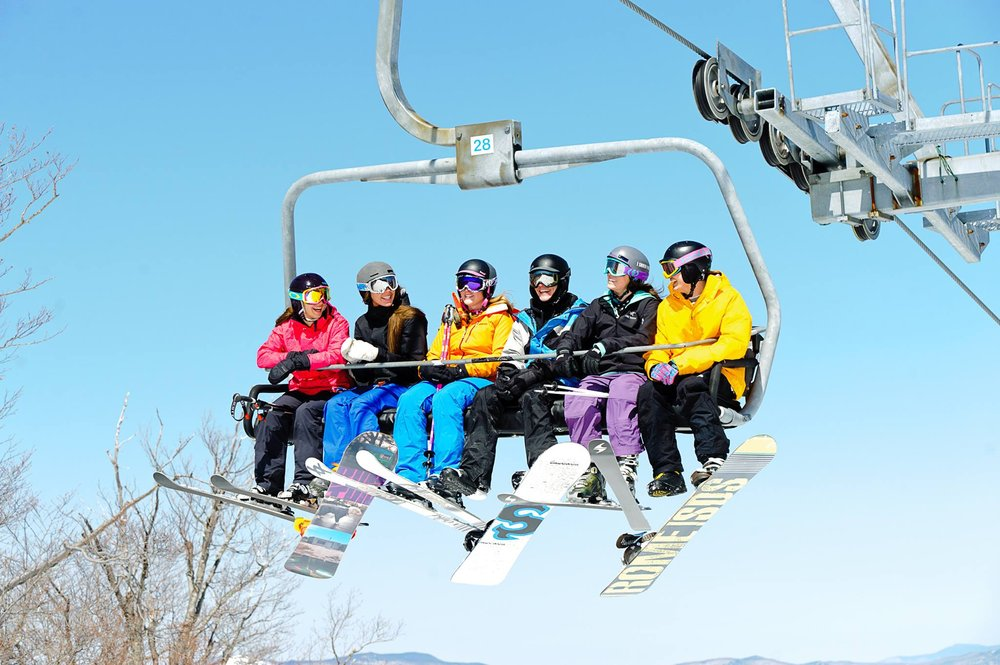 Sharing a chair beats sharing a cab any day. - ©Stratton Mountain Resort