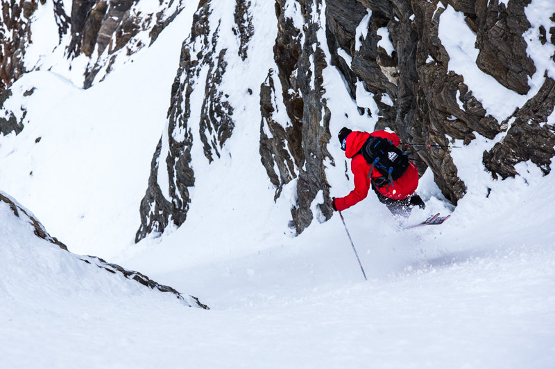 Todd LIgare skiing a steep chute in Door 1, Revelstoke.  - © Liam Doran