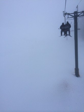 Super heavy wet snow.. Super foggy, and chair one is closed due to wind..