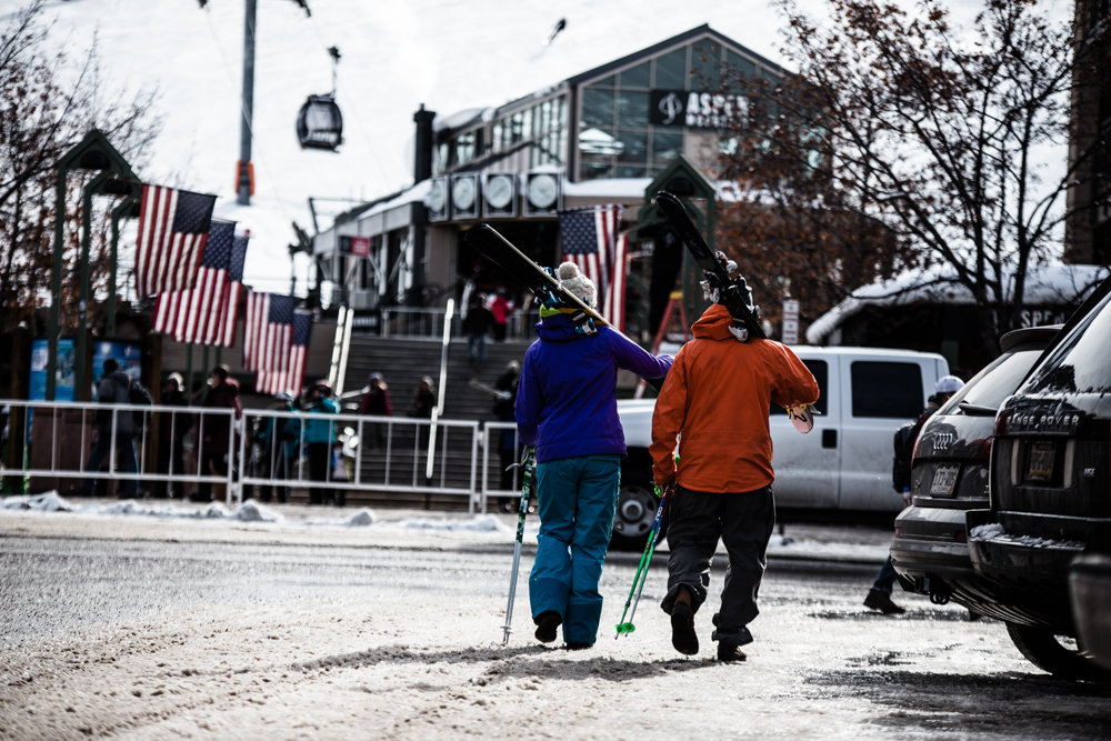 Darcy Conover and Adam Moszynski make their way off the mountain to one of Aspen's many great apres ski bars. - © Liam Doran