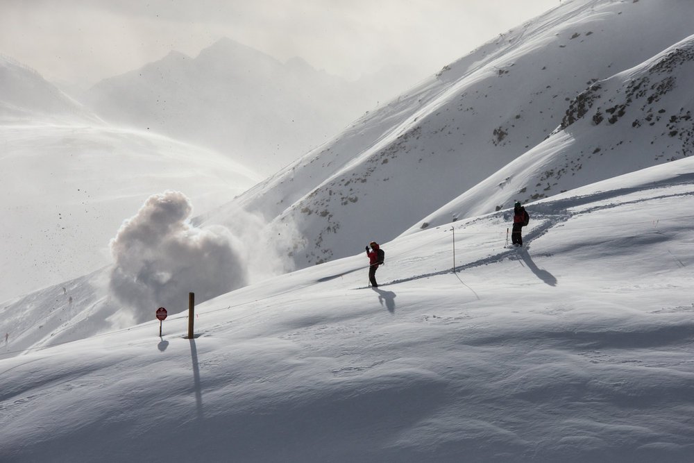 Ski patrollers doing control work at Lake Louise. - © Liam Doran