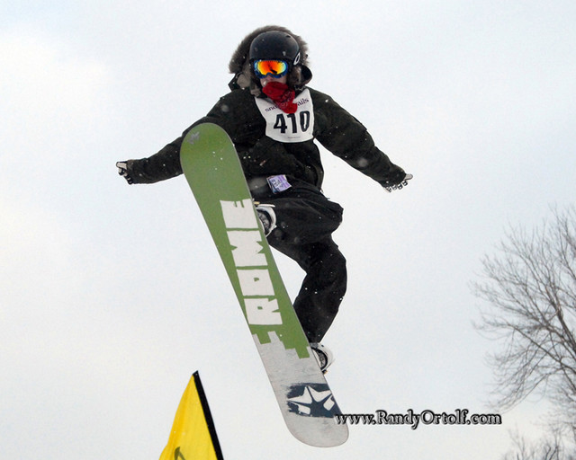 A snowboarder gets big air in the terrain park in Snow Trails, Ohio