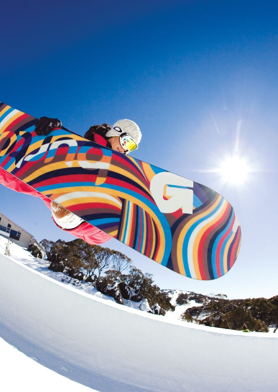 A female boarder in the pipe at Perisher.