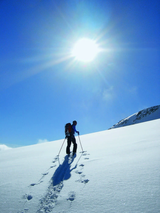 A ski hiker trekking across Saas Fee.