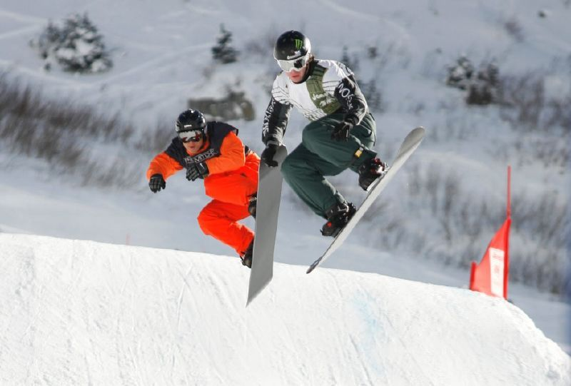 Two snowboarders race in Snowbird, Utah