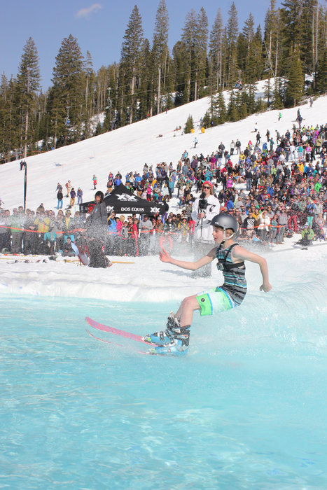Big Sky's annual season-end pond skim celebration. - © Michel Tallichet