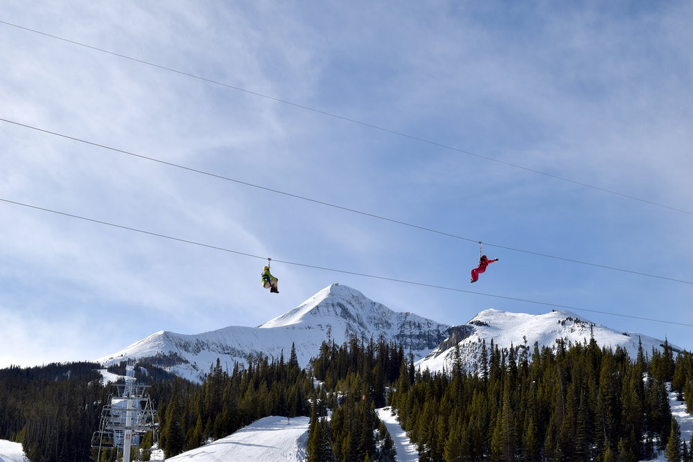 Seven ziplines on two courses flank Lone Peak at Big Sky. - © Michel Tallichet