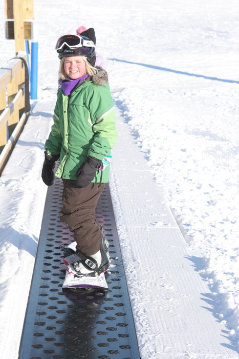 Young boarder on magic carpet at Wild Mountain, MN