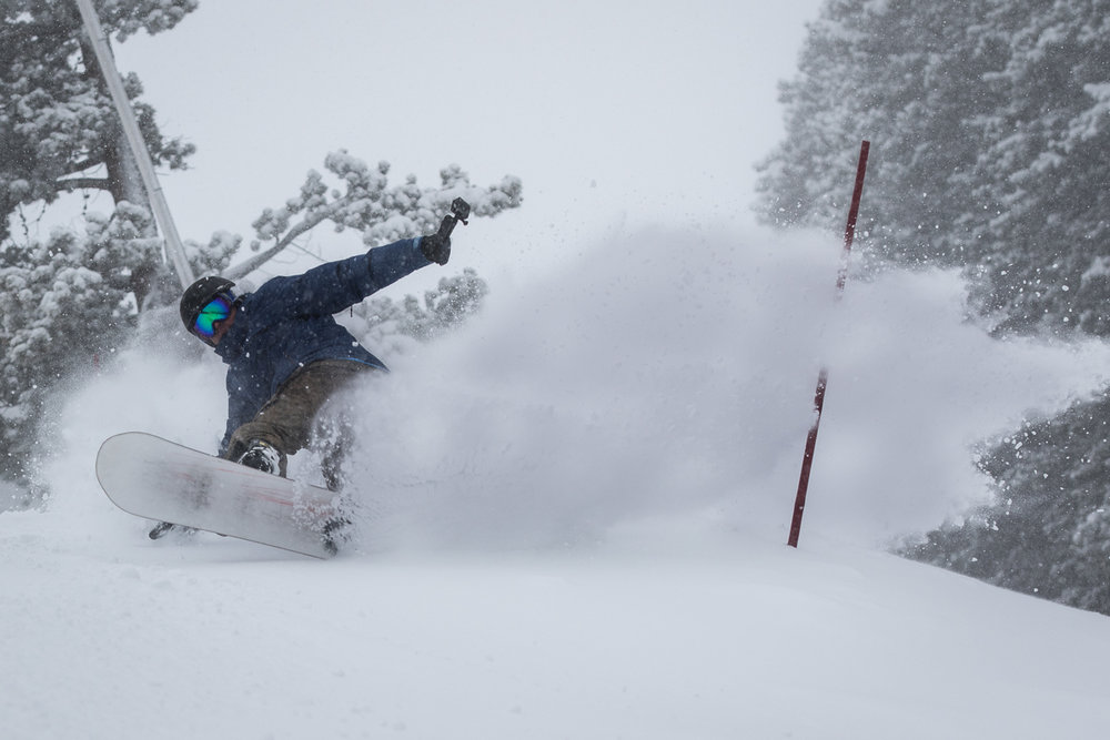 A snowboarder enjoys fresh powder on Peak 9 at the Breckenridge Ski Resort - © Breckenridge Ski Resort