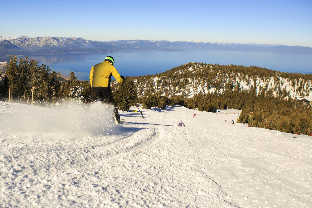 Sunny skies delivered at stellar opening day at Heavenly with views of Lake Tahoe.              - © Heavenly/Vail Resorts