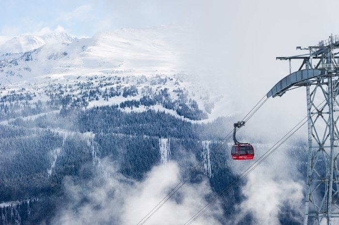 Peak-2-Peak climbs out of the clouds at Whistler Blackcomb. - © Mike Crane/Tourism Whistler