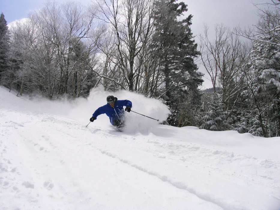 Skier in deep powder at Smugglers' Notch, Vermont.
