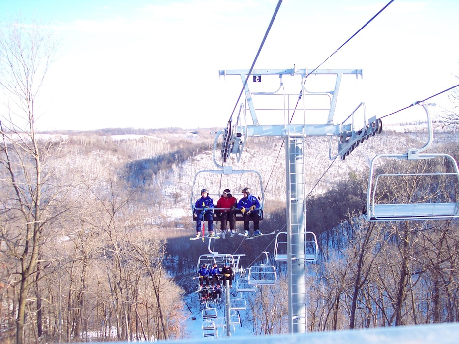 Skiers on chairlift at Welch Village, MN.