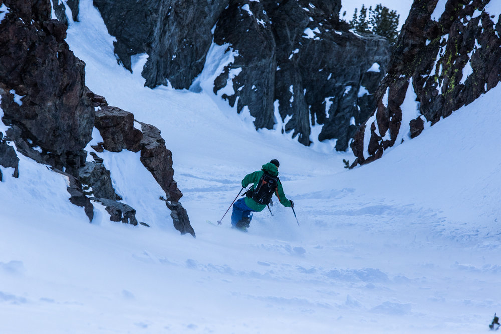 Sven Brunso makes his way down a powdery corridor after a long tour in June Mountain's backcountry near Mammoth Lakes. - © Liam Doran