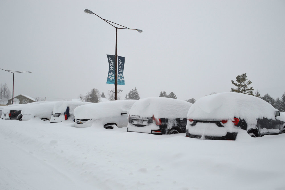 Cars buried in 3-foot drifts at Wisp Resort in Maryland. - © Wisp Resort