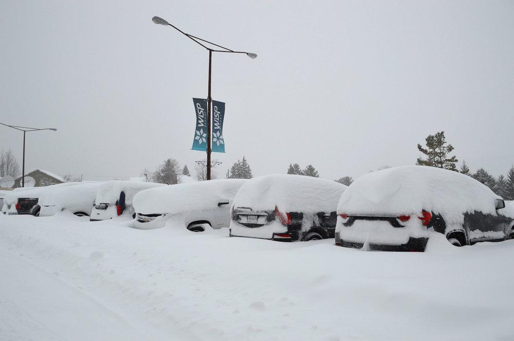 Cars buried in 3-foot drifts at Wisp Resort in Maryland. - © Wisp Resort