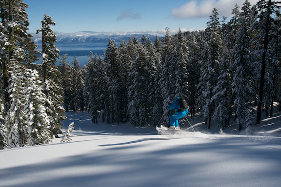 A skier descends Ellis Peak toward Lake Tahoe. - © Homewood Mountain Resort