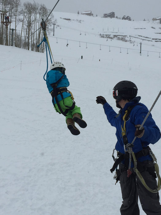 Parents and kids zig zag down the ski hill on five different ziplines, all connected by suspended wood bridges and high platforms.  - © Krista Crabtree