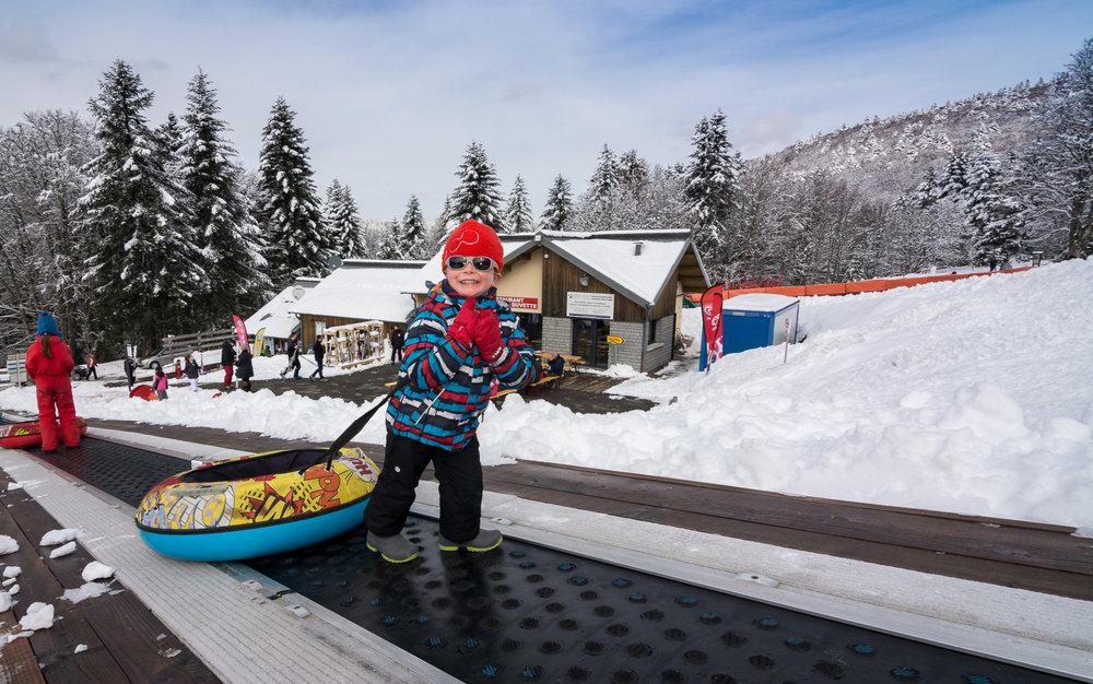 Les plaisirs de la glisse sur la piste de snow tubing de la Planche des Belles Filles - © Thomas-Devard