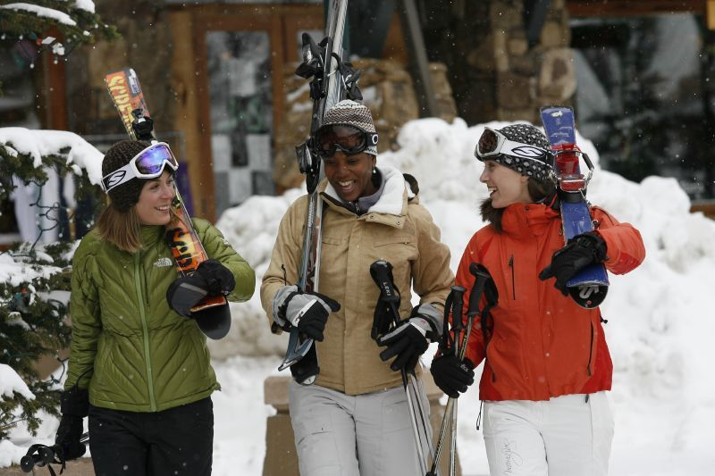 Three women with skis in Winter Park Resort, Colorado