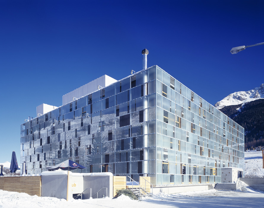 Cube Hotel exterior in Savognin with mountainside behind