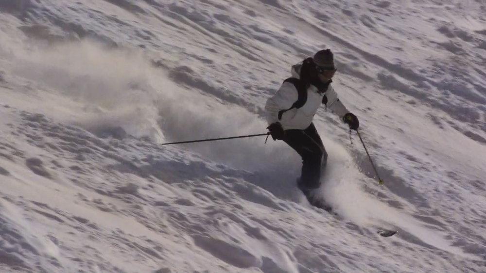 Skier in fresh powder at Cairngorm, Scotland