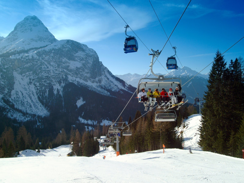 Skiers headed up a lift at Ehrwald, Austria.