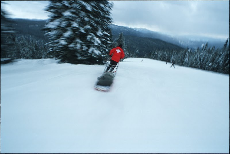 Ski patroller with rescue sled at Lost Trail, Montana.