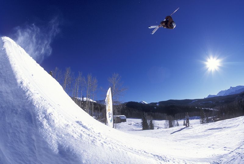 This skier gets big air off a jump in the terrain park in Telluride, Colorado