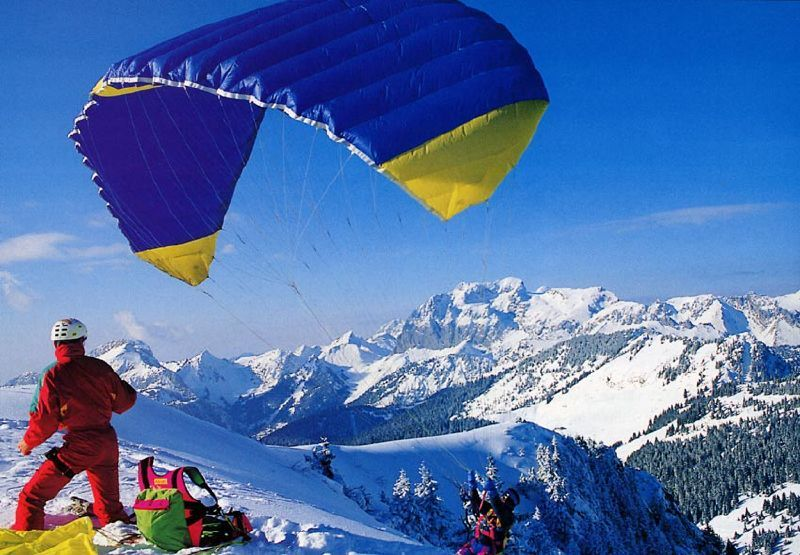 Parasail skiers taking off in Chatel, FRA
