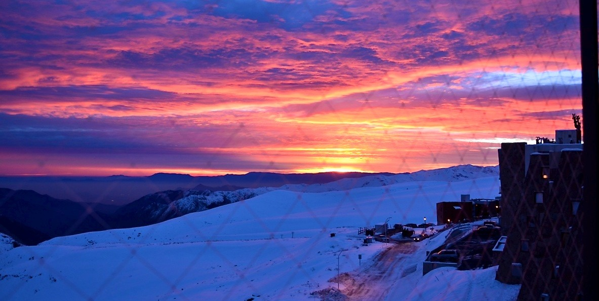 No snow falling means a beautiful sunset over the mountain's at La Parva Ski Resort in Chilie - © Travis Ganong