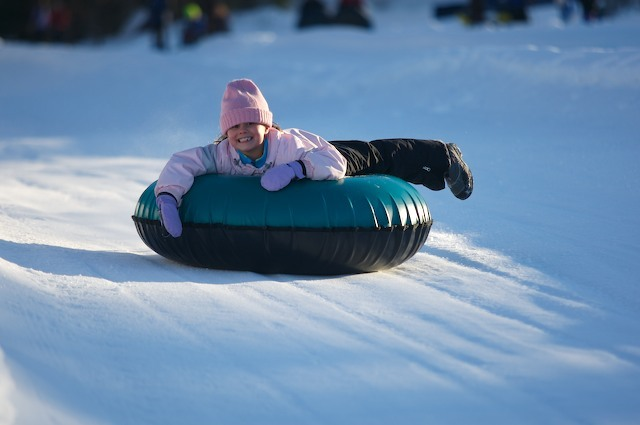 A little girl takes a run down the tubing lane. Photo Courtesy of Pats Peak.