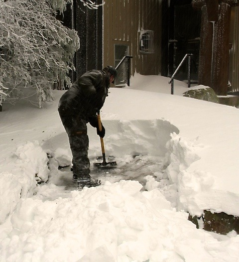 Shoveling the snow at Snowshoe. Photo Courtesy of Snowshoe Mountain Resort