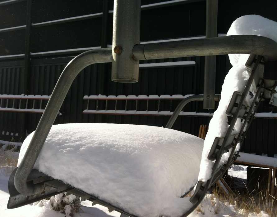 A chair lift blanketed by the new snow. Photo credit: Heavenly