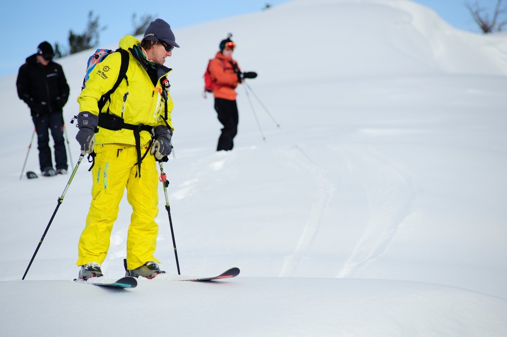Scoping out lines with Sun Valley Heli-Ski Guides. - © Tal Roberts