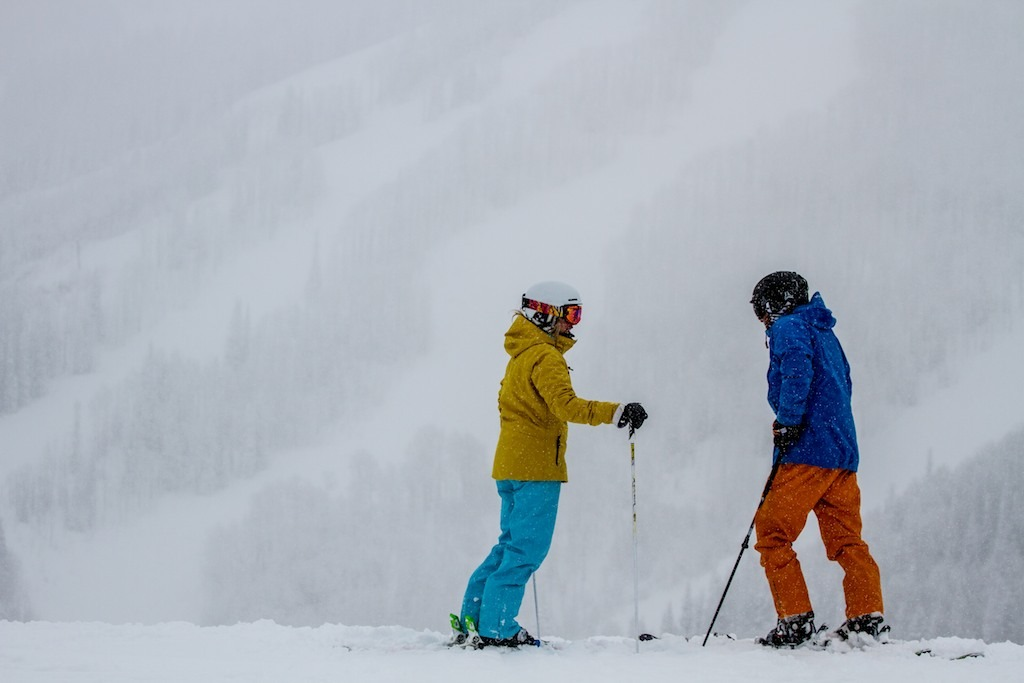Caroline Lalive and Mike Maroney gazing at the runs of Storm Peak. - © Liam Doran