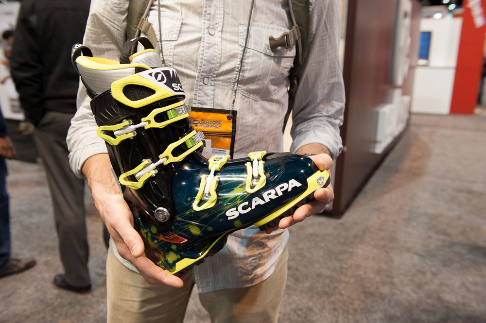 Scarpa's Freedom SL is a true one-quiver ski boot that is high performing when touring and skiing the resort. It weighs in at a miniscule 3 lbs 13 oz for each boot, and had a molded carbon fiber frame in the upper boot for increased stability and the cuff has an amazing 27-degree rotation when in walk-mode for those long tours.  - © Ashleigh Miller Photography