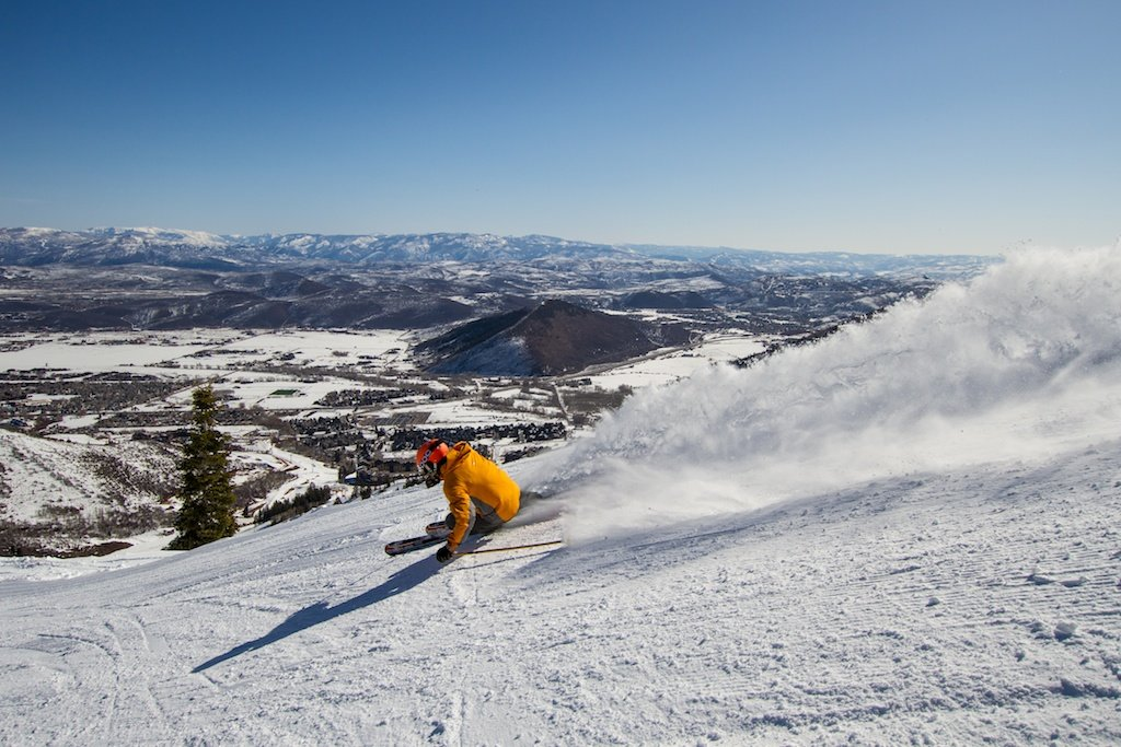 Former World Cup Alpine Ski Racer Erik Schlopy rips up a groomer at Canyons in Park City, Utah. - © Liam Doran