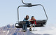 Visitors to Mt. Bachelor, OR on a chairlift.
