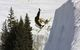 This snowboarder performs a grab in the air in Crested Butte, Colorado