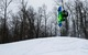 Snowboarding does a backflip at Christie Mountain. - ©Christie Mountain