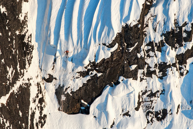 Skier Dean Cummings drops a cliff on his Mount Francis descent.  - © Eric Layton