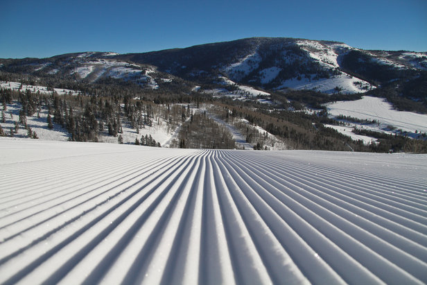 Groomed corduroy snow beckons skiers at Beaver Mountain for its 75th anniversary season.