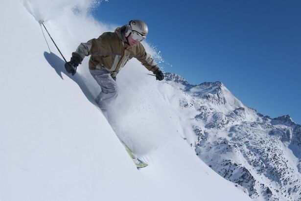 A skier enjoys fresh powder at Grandvalira Andorra