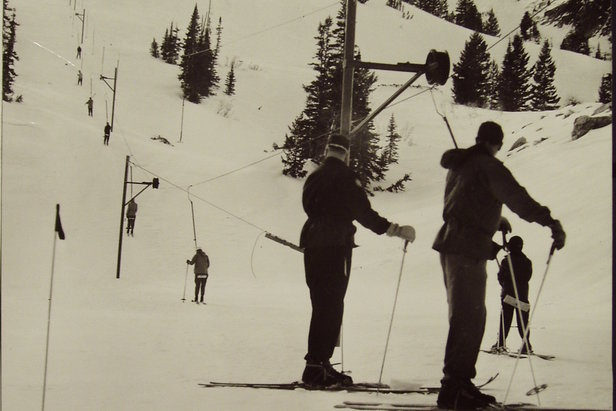 The Porcupine Saddle rope tow hauls skiers up Snow Basin in 1956.  - © Snowbasin Resort